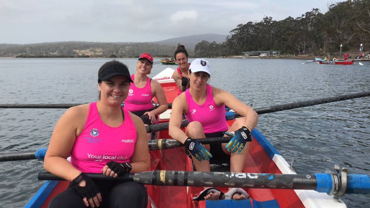 The women's division winning crew from Broulee celebrate at the finish of the Club to Pub in Pambula Lake last year.