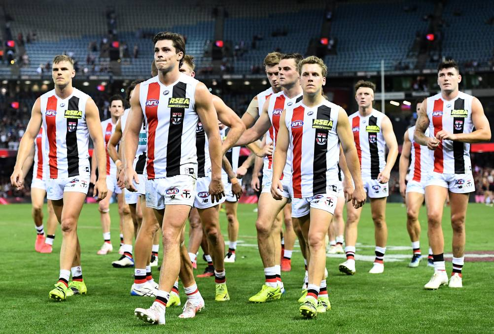 LOSS: Jack Steele and his Saints teammates look dejected after losing against Essendon. Photo: Quinn Rooney/Getty Images