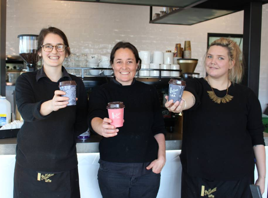 Drink coffee, do good: Waterfront Cafe staff Phoebe Gregoire, Sarah Magee and Claire Jungwirth encourage people to grab a coffee on August 5 to help those in need.